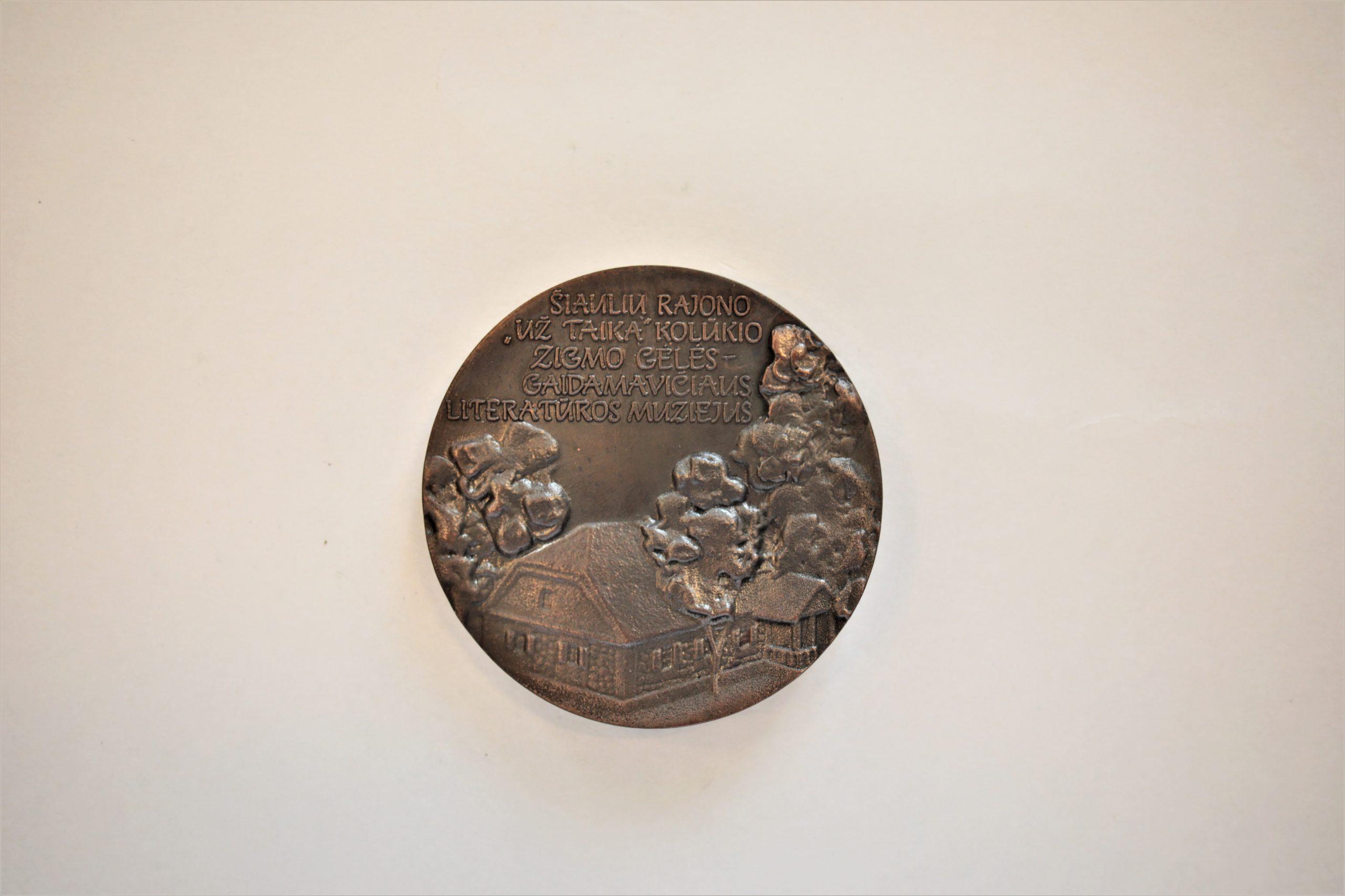 Medalis. Zigmo Gėlės – Gaidamavičiaus literatūros muziejus. Metalas. Reversas. Autorius nežinomas